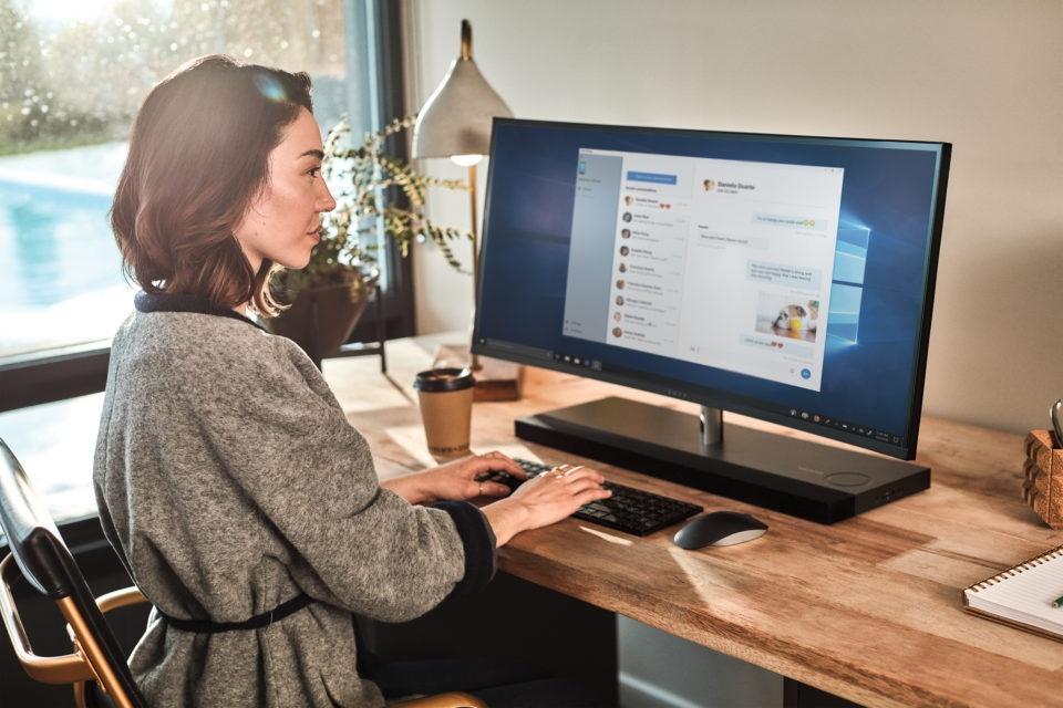 microsoft woman at home desk 1 960x640